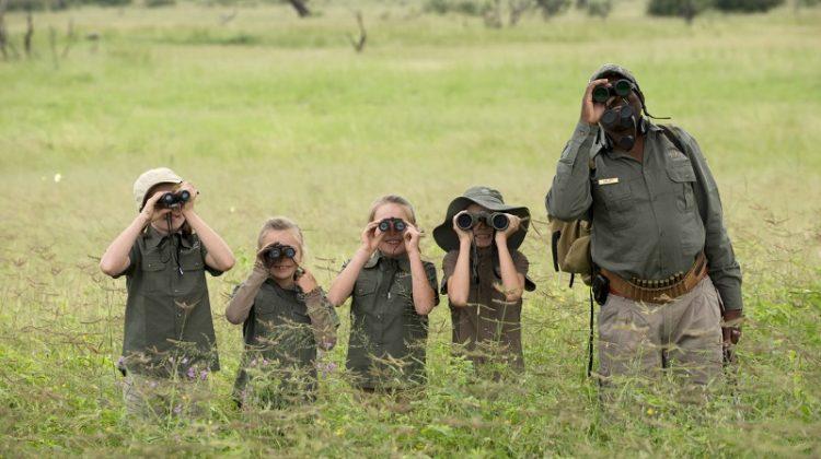 Two Kenyan children dressed in Masai dress - family safaris