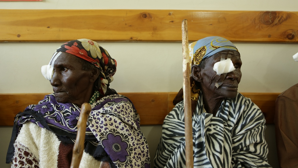 Two elderly ladies recovering from treatment with patches over one eye