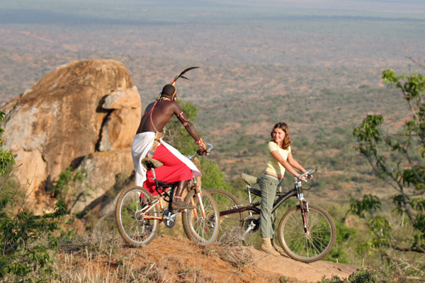 Mountain biking with a guide, Loisaba, Kenya