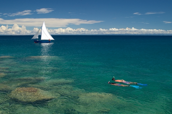 Scuba diving in the crystal clear waters of Lake Malawi at Kaya Mawa