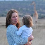 Alice with her daughter, with giraffes, Kenya