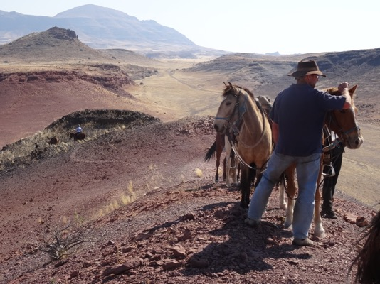 Anneman and guide on hill Namibia Horse Safaris