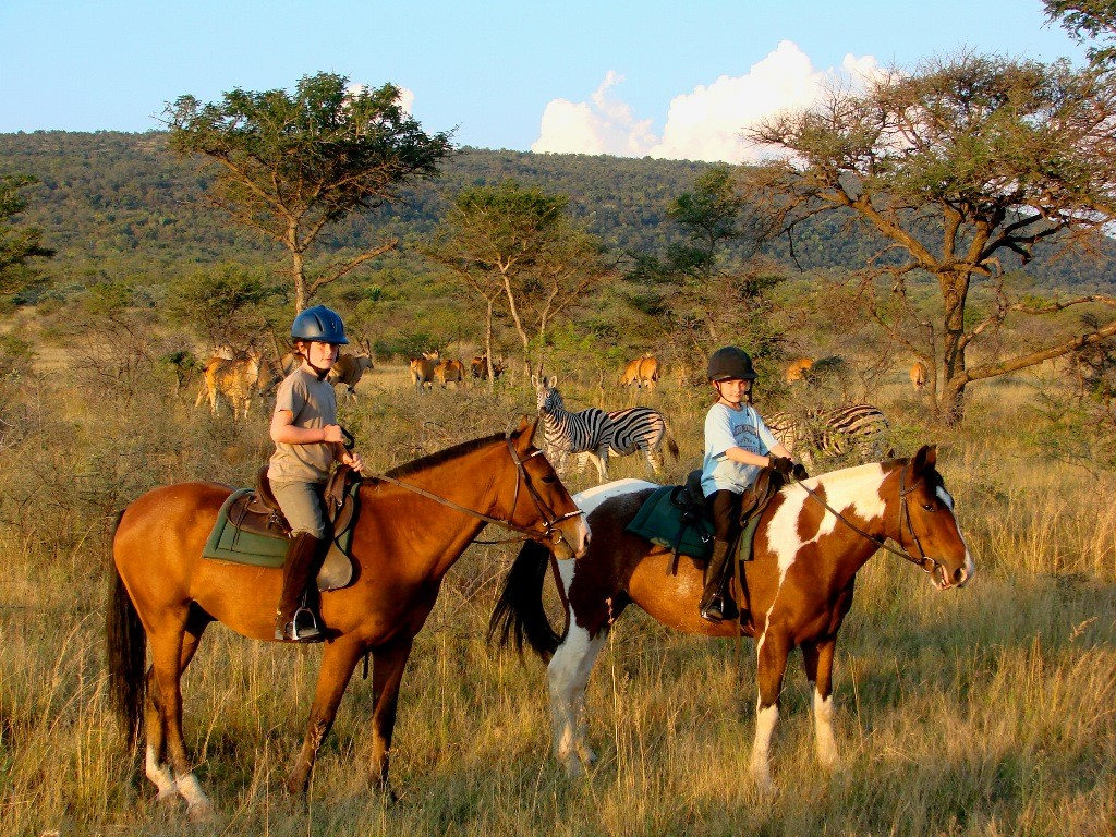 Ants Hill children on horseback, Ants Hill and Ants Nest, Waterberg, South Africa