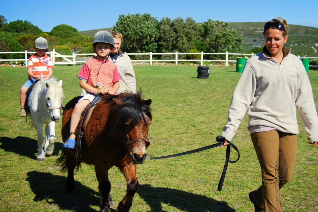 Children at Riding School paddock, Grootbos Riding, Garden Route, South Africa