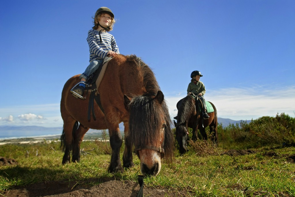 children riding ponies by the sea, Grootbos Riding, Garden Route, South Africa
