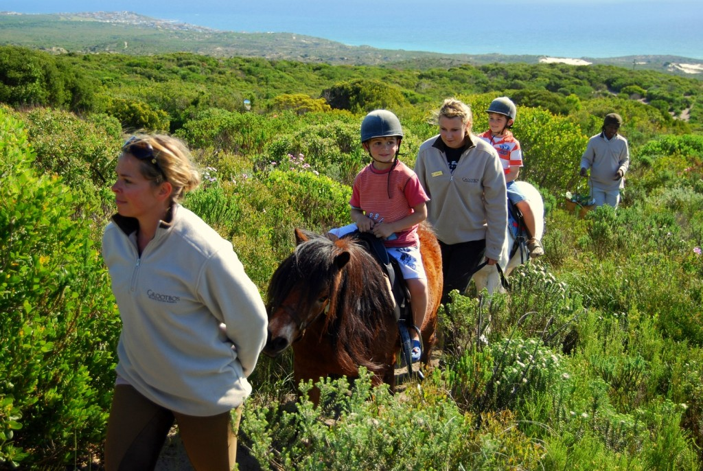 Children riding on reins, Grootbos Riding, Garden Route, South Africa