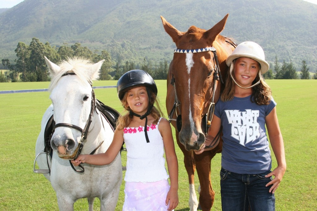 kids enjoying the ponies, Kurland Riding, Garden Route, South Africa