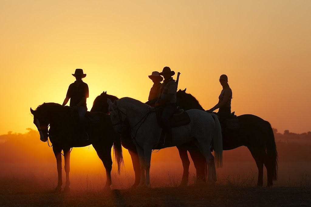 Riders at sunset, Tuli, Botswana