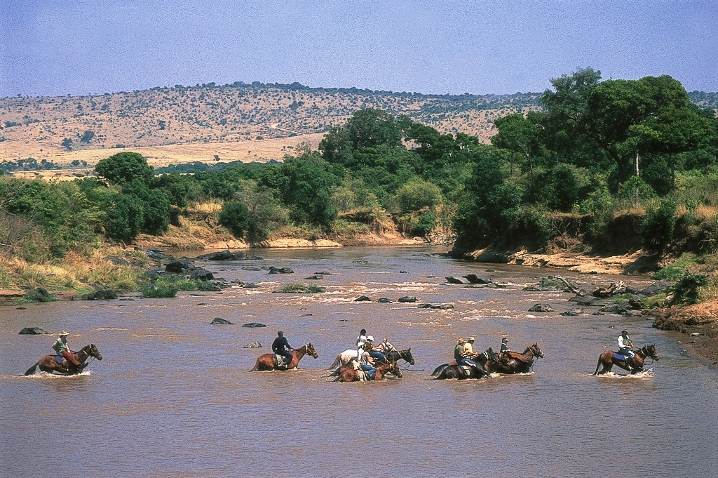 A river crossing convoyof riders, Offbeat Riding Safaris, Kenya