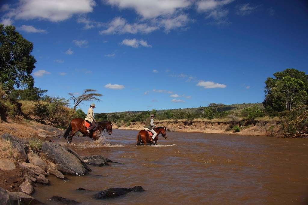 Hippos and riders in the river, Kenya, Safaris Unlimited riding safari holiday