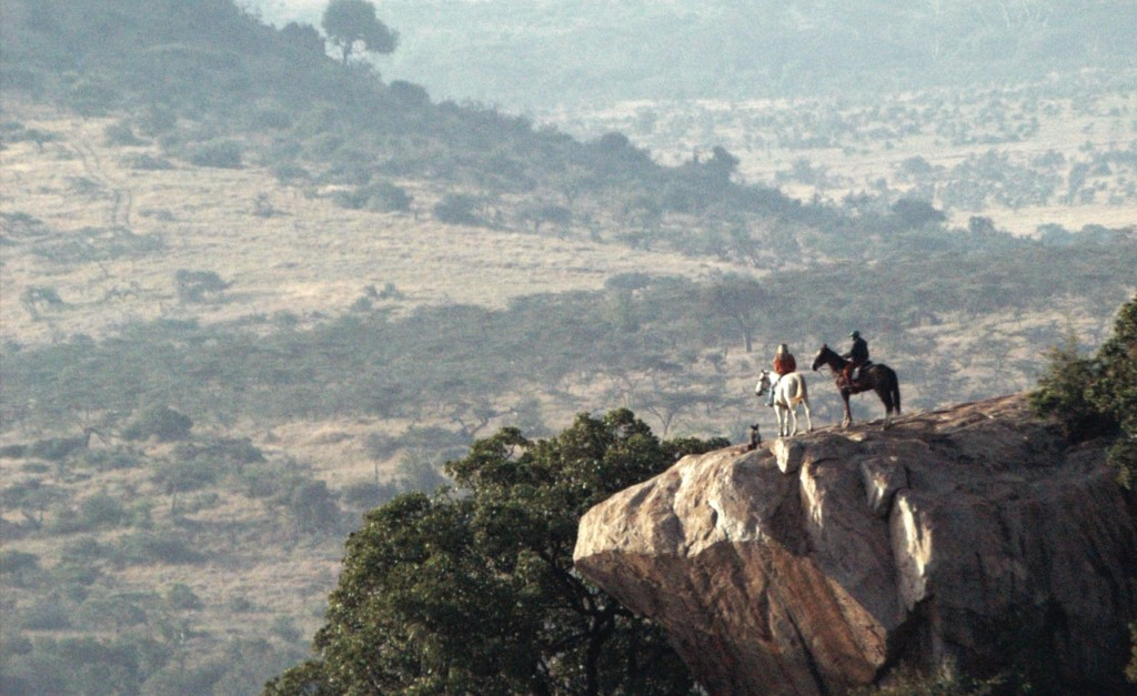Two riders on an cliff outcrop, Borana Riding Wild, Kenya