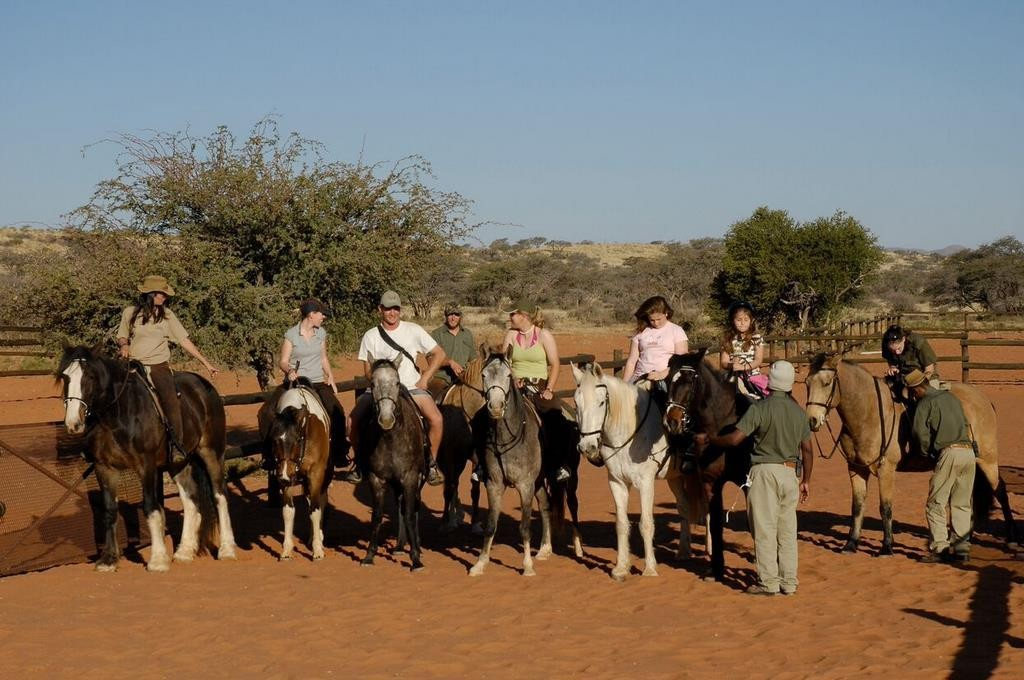 Children setting off for a group hack, Tswalu, Kalahari, South Africa