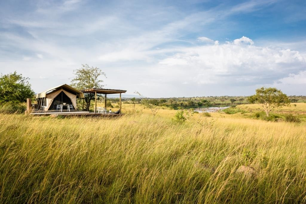 Wildebeest Migration tent site - Singita Mara River Camp Serengeti Tanzania