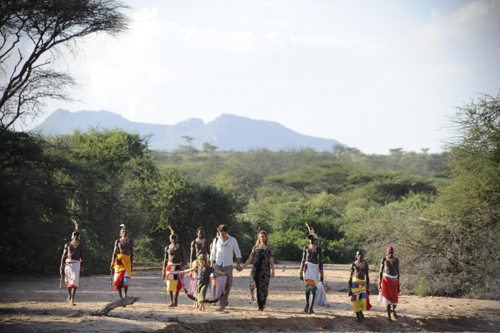 Saba and family walking with Samburu tribe on a dry river bed at Elephant Watch camp