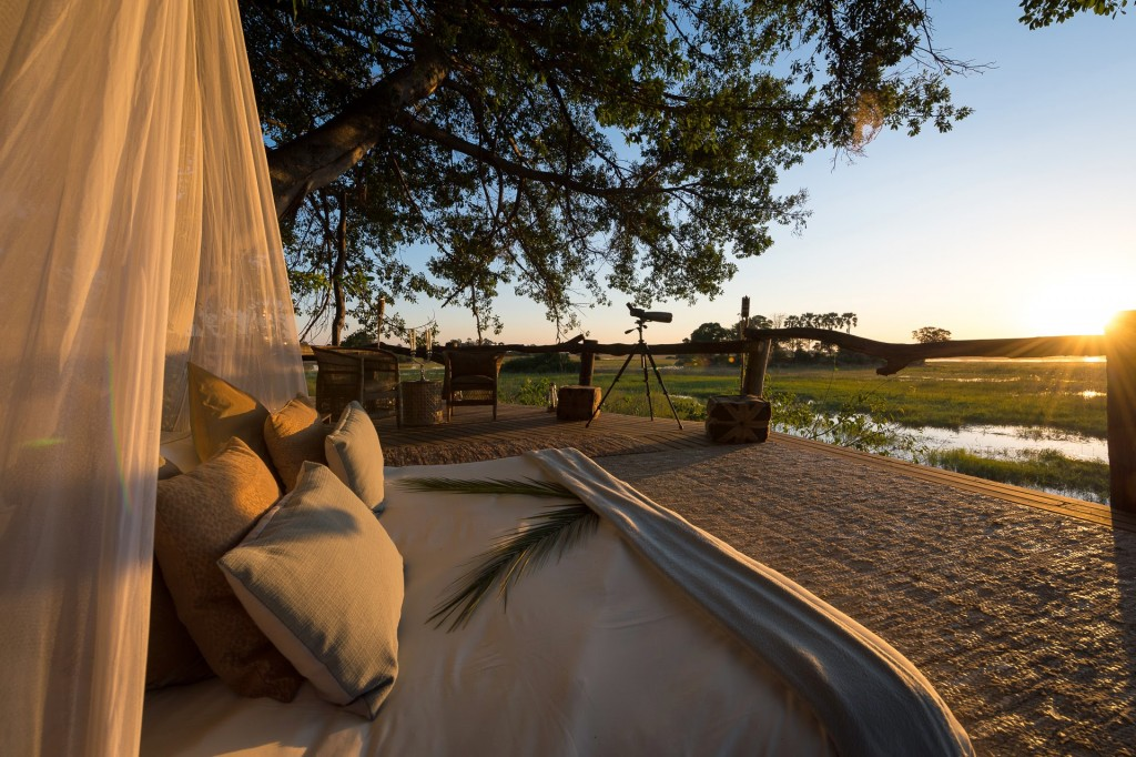 Sunrise in an open bedroom and long range lens camera Okavango Delta scenery at Tubu Tree Camp