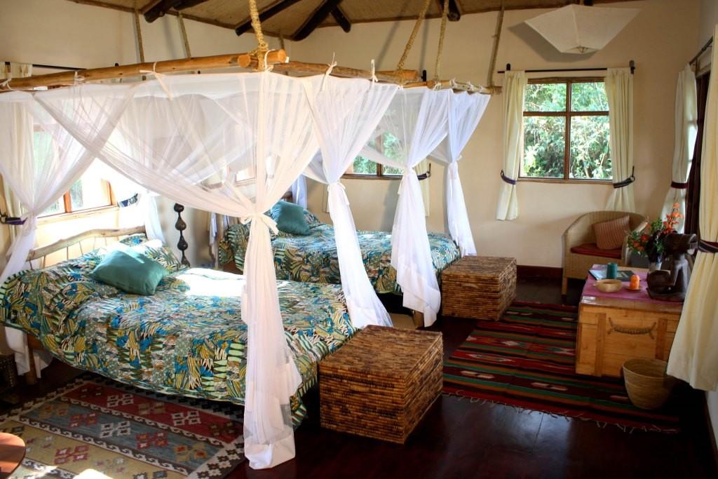 Cosy lodgings and four poster luxury Image credit: Virunga Lodge, Rwanda