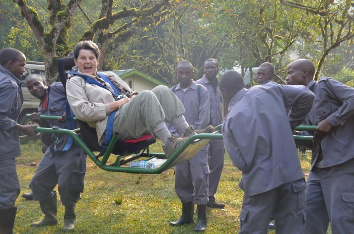 lady in a gorilla sedan chair with porters http://carolyntravels.com/