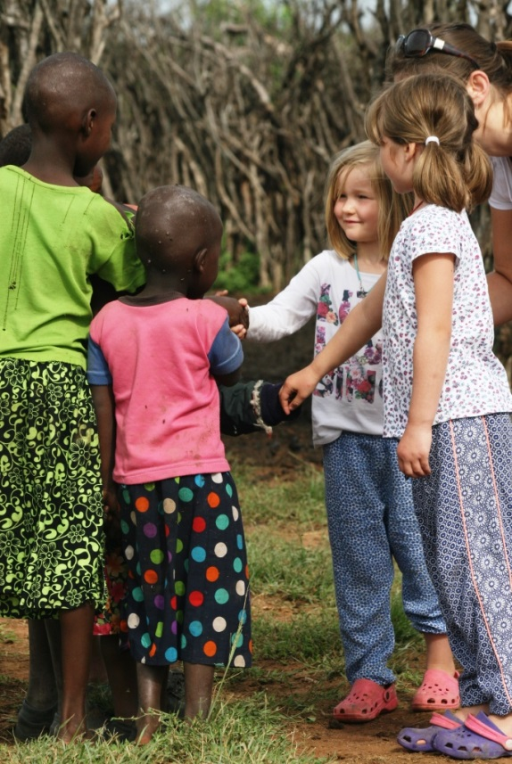 Children shaking hands from different nationalities