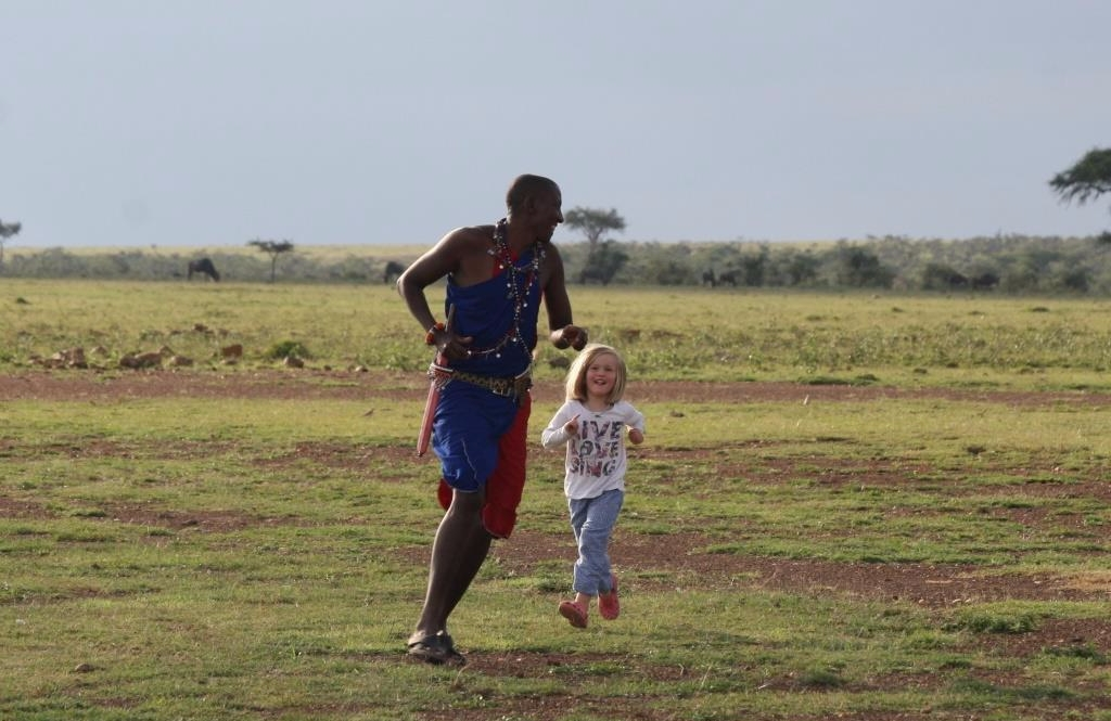 Maasai man David playing with a young girl