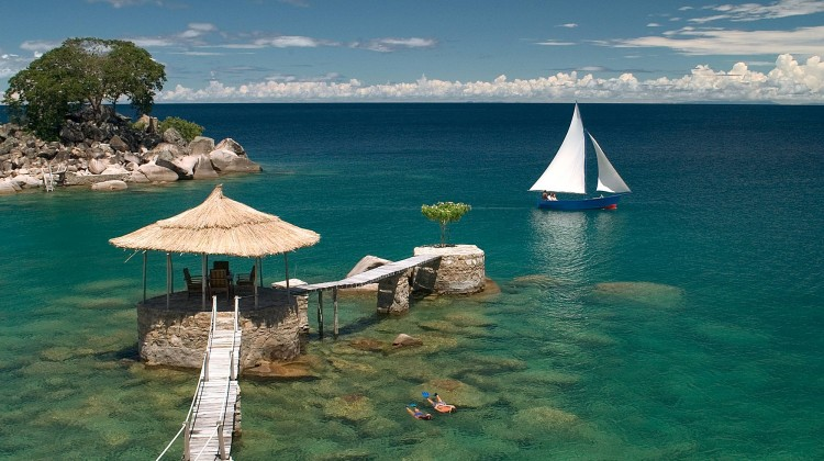 Snorkellers, Lake Malawi and jetty and sail boat