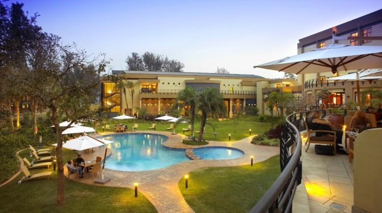 How To Gorilla Track In Rwanda - Serena Hotel pool, Kigali, Rwanda