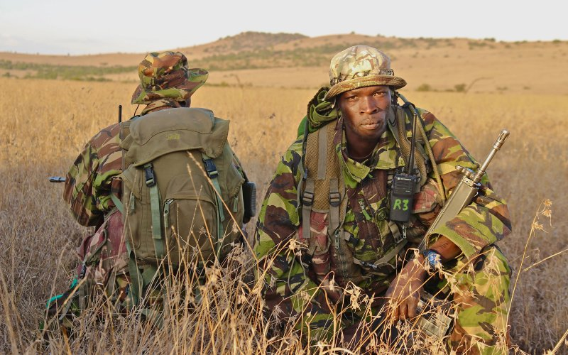 Camouflaged rangers on guard to protect rhino