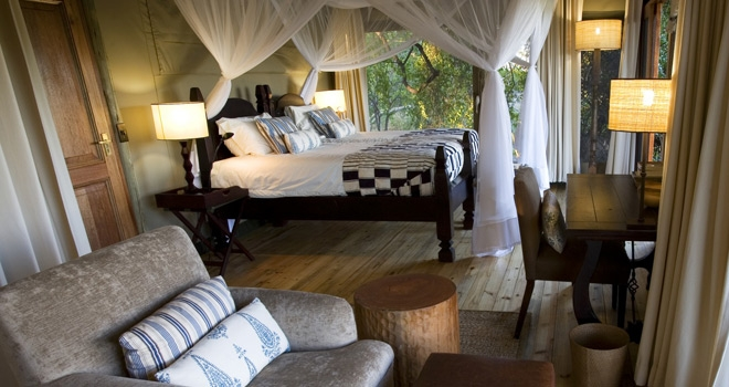 Luxury balc and white four poster Bedroom at Little Vumbura, Okavango Delta, Botswana