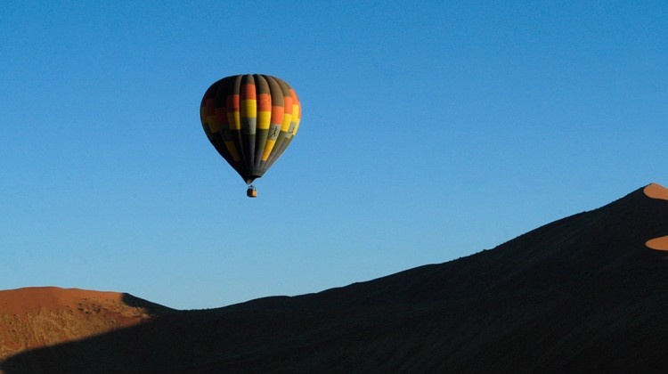 Balloon flying over Namibia's dunes, Wolwedans Private Camp