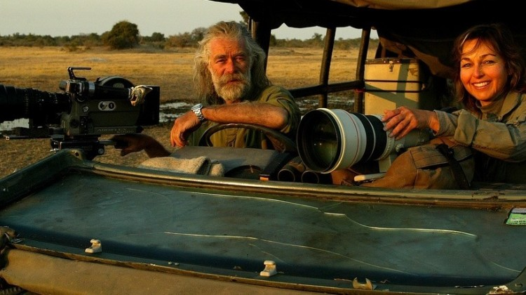 National Geographic photographers Dereck and Beverly Joubert - in their safari vehicle with long range lenses