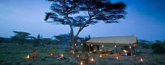Mobile safaris - camp lit up with lanterns