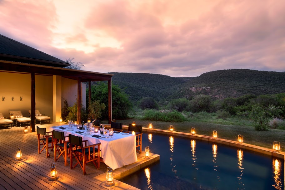 dining and pool night scenen The outback can be refined at Kwandwe Melton Manor, Eastern Cape, South Africa