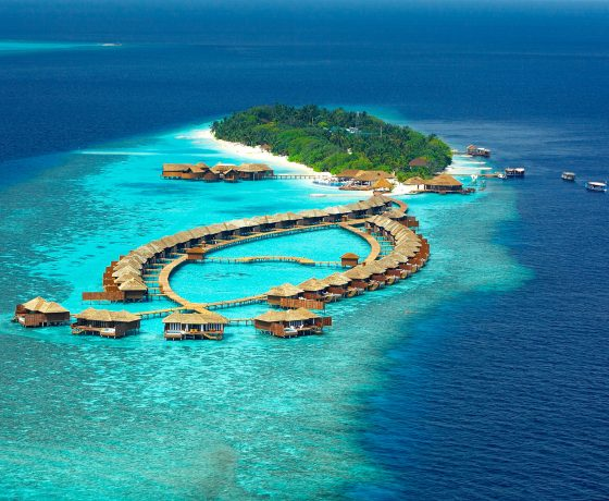 Lily Beach aerial photo island and water bungalows, reef and boats