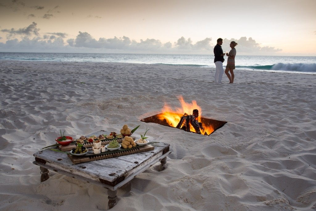 Romantic dinner and drinks on the beach, North Island, Seychelles