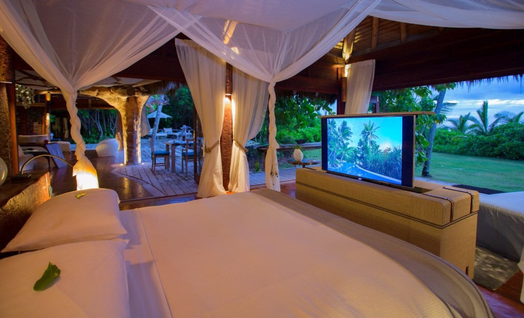 Presidential suite - tv in bed, North Island, Seychelles