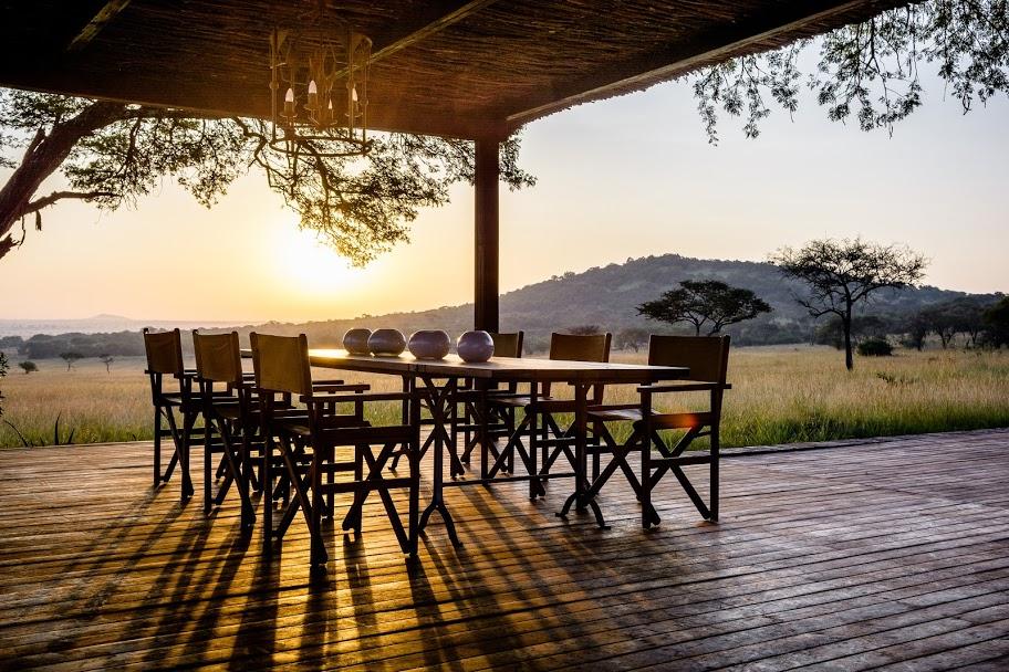 Sunrise The dinner table is the heart of the home at Singita Serengeti House, Serengeti, Tanzania