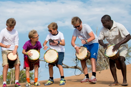 Wilderness Safaris - children drummy with a Bush Buddy
