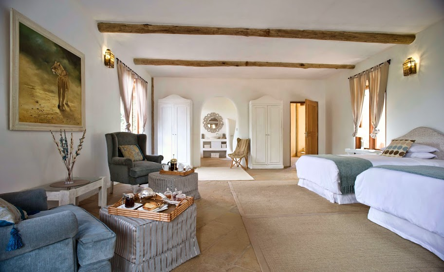 Cool, calm and contemporary bedroom white suites at Cottar's Private Homestead, Masai Mara, Kenya