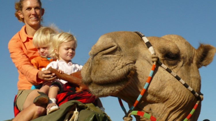Karisia Camel Walking Safari young children riding with mother on camel
