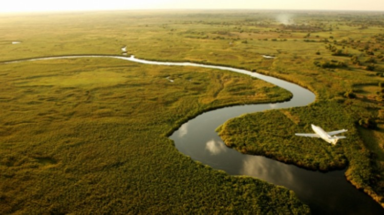 Okavango Delta aerial Botswana river meandering and light aircaft