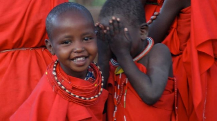 Two Kenyan children dressed in Masai dress