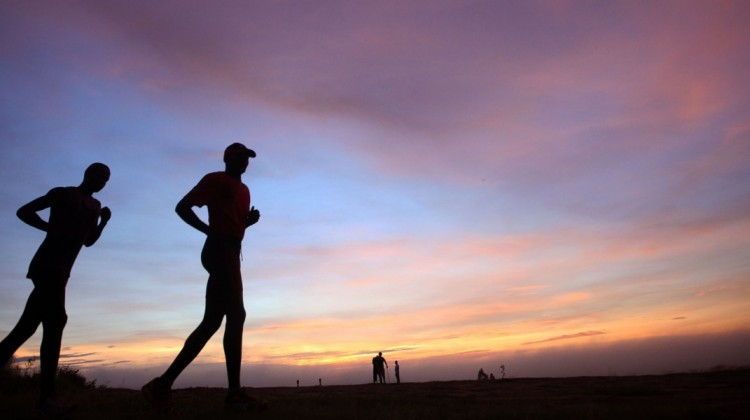 runners running in an African marathon at sunset