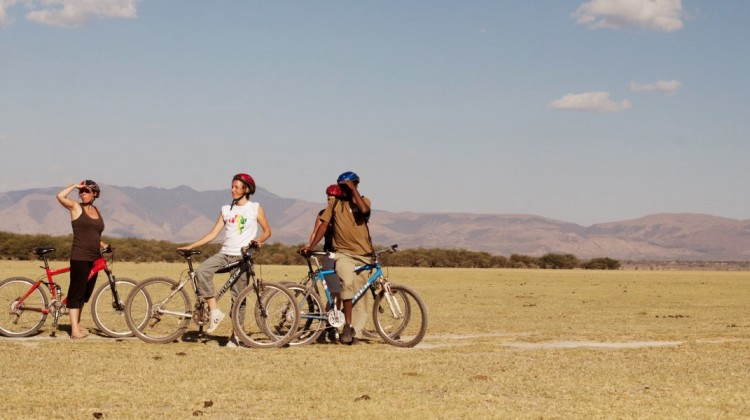 Four cyclists at Wayo Africa Lake Manyara National Park Tanzania