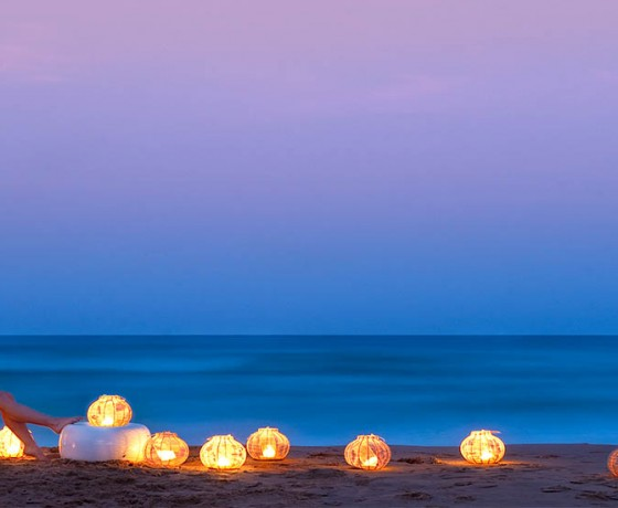 White Pearl Resorts, Ponta Mamoli, Mozambique Beach Dusk - lights on beach, lady on beach chair hammock seat