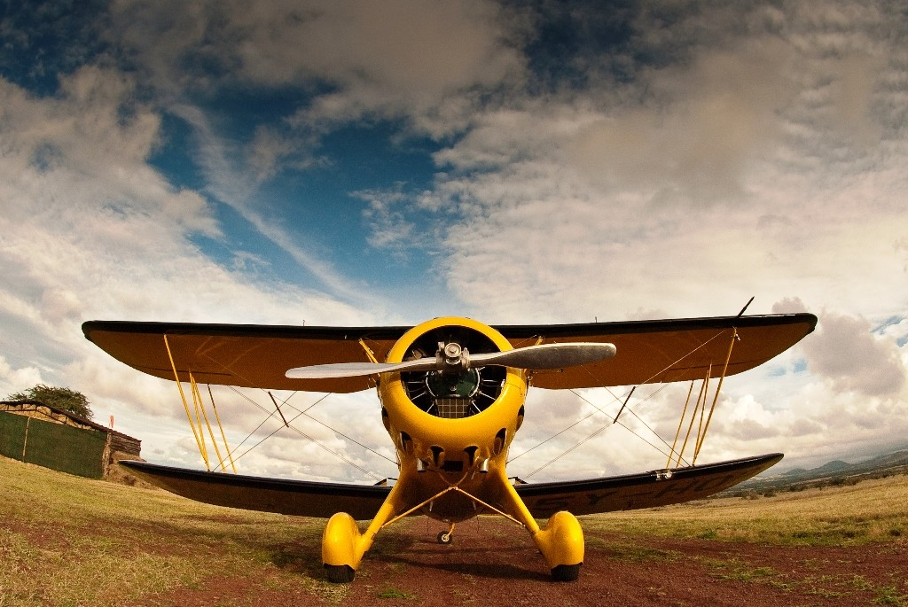 Yellow biplane on a runway