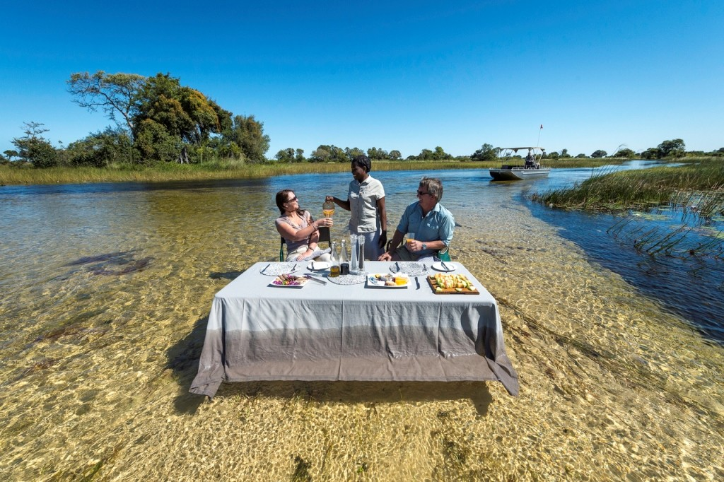 Dining on the river, Pelo Camp, Okavango Delta, Botswana