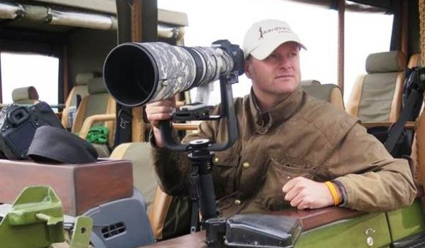 David Murray photographic safari guide with his long lens camera on a safari vehicle