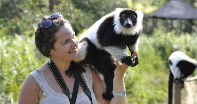 Guest with lemur, Vakona Lodge, Andasibe, Madagascar