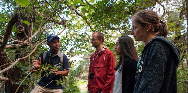 Wildlife Holiday in Madagascar guide teaching young students about Malagasy wildlife Manafiafy