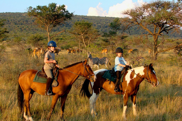Children on horseback, Ants Hill and Ant's Nest, Waterburg, South Africa