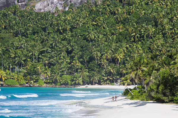 North Island, Seychelles, couple on beach